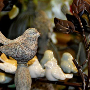 Bird figurines at Zinnia's store; image